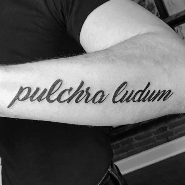Male Tattoo With Latin Design Outer Forearm