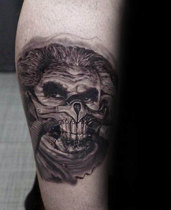 Male Tattoo With Mad Max Design On Inner Forearm