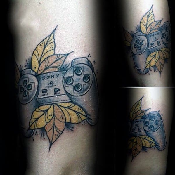 Male Tattoo With Playstation Design On Arm