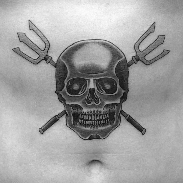 Male Tattoo With Skull And Trident Design On Chest