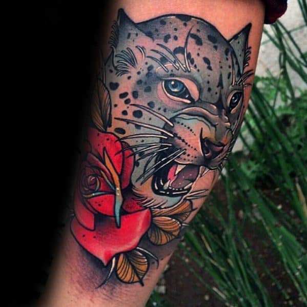 Male Tattoo With Snow Leopard Design