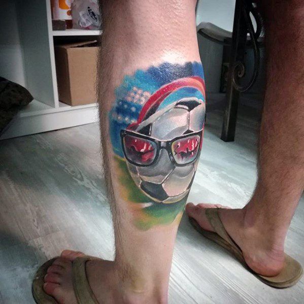 Male Tattoo With Sports Design On Leg Calf