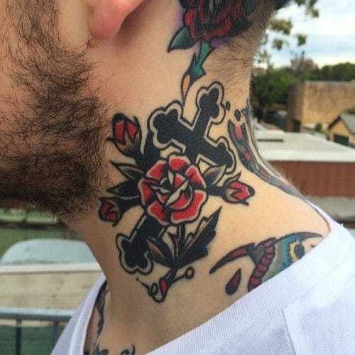 Male Tattoo With Traditional Cross Design