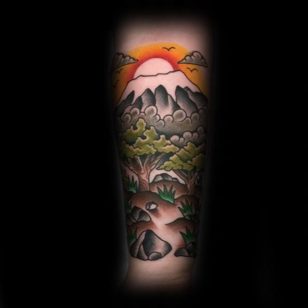 Male Tattoo With Traditional Mountain Design