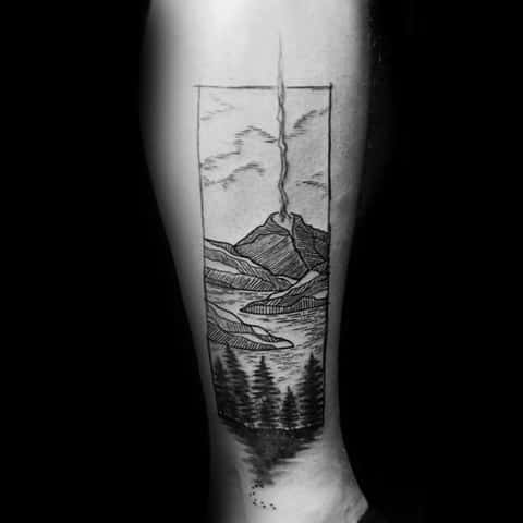 Male Tattoo With Volcano Design On Side Of Leg