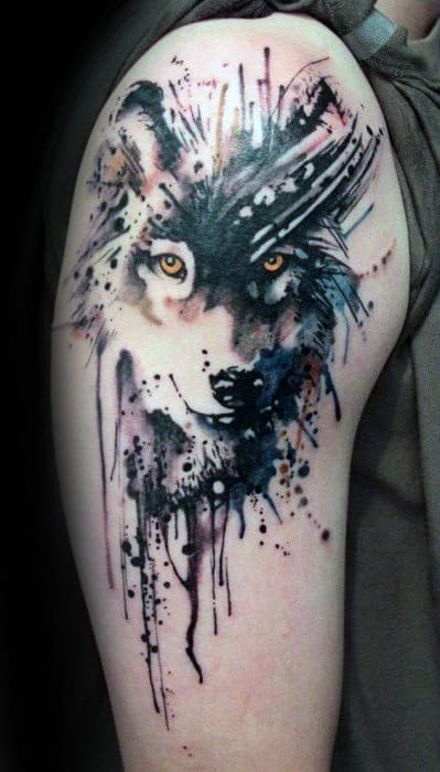 Male Tattoo With Wolf Watercolor Design On Upper Arm