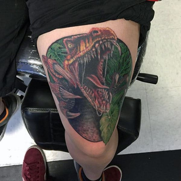 Male Thighs Hungry Dinosaur In Forest Tattoo