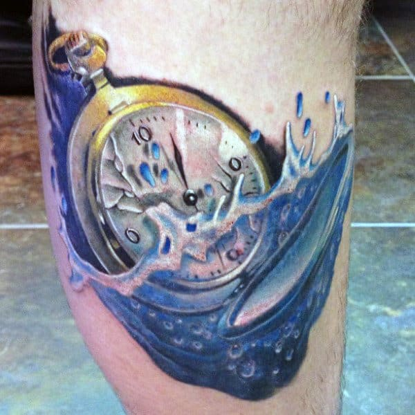 Male Thighs Interesting Tattoo Of Clock In Water