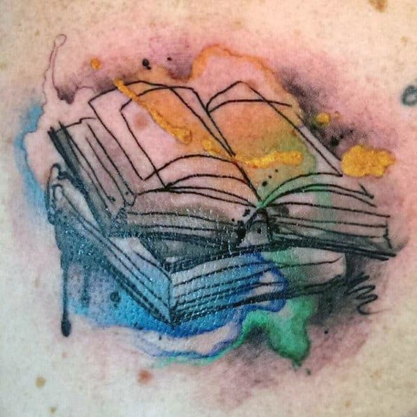 Male Torso Books And Magical Colors Tattoo