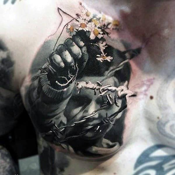 Male Torso Realistic Tattoo Of Boy Holding Colored Blooms