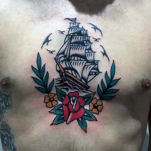Male Traditional Flower Sailing Ship Tattoo On Upper Chest