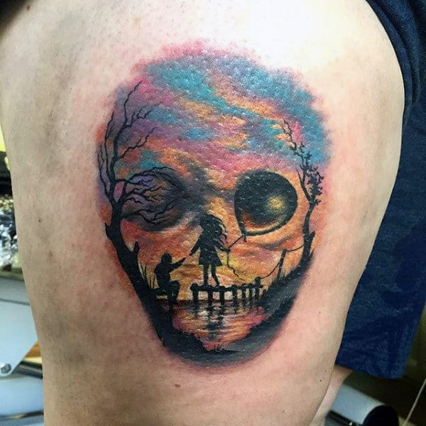 Male Traditional Tattoo Children At Sunset That Looks Like Skull On Thigh