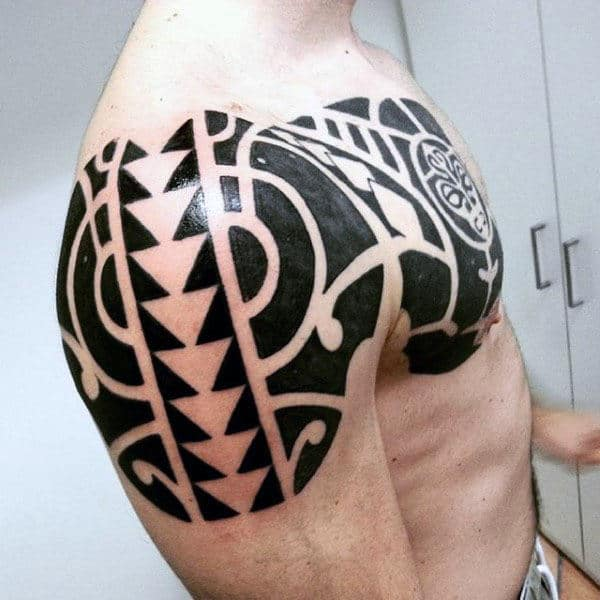 Male Tribal Arm And Chest Tattoo Ideas
