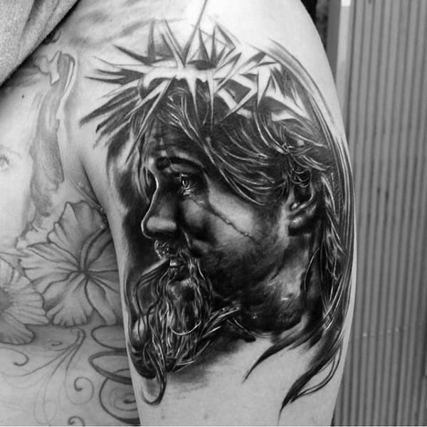 Male Upper Arm Jesus Christ Face Tattoos