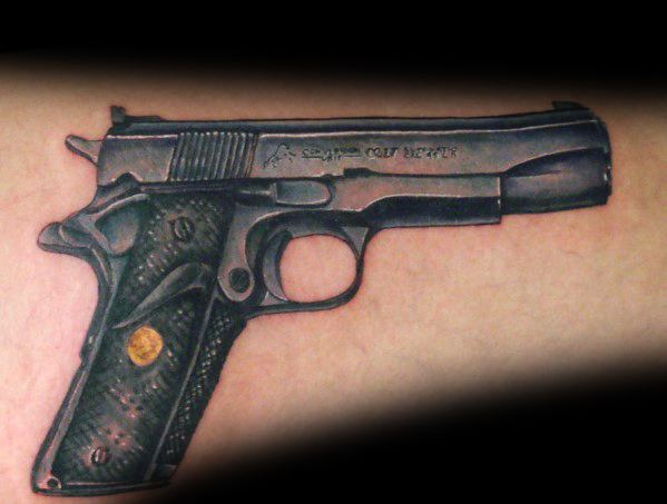 Male With 1911 Tattoos On Arm