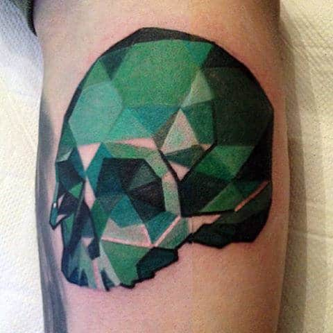Male With 3d Green Crystal Skull Tattoo On Arm