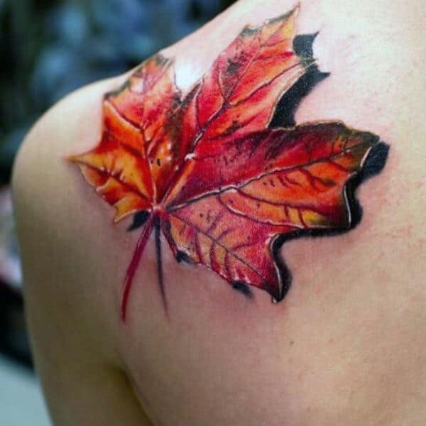 Male With 3d Orange Leaf Fall Upper Back Shoulder Tattoo