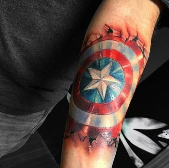 Male With 3d Ripped Skin Captain America Shield Tattoo Inner Forarem