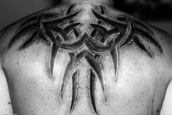 Male With 3d Sick Tribal Upper Back Tattoo Design