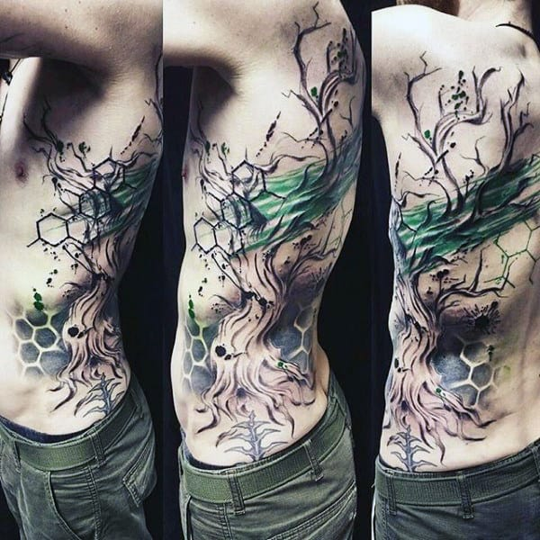 Male With Amazing Tree Tattoos On Ribcage With Watercolor Design