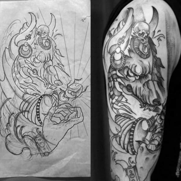 Male With Anubis Upper Arm Tattoo