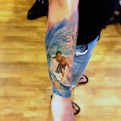 Male With Artistic Watercolor Tattoo Of Surfing On Forearms