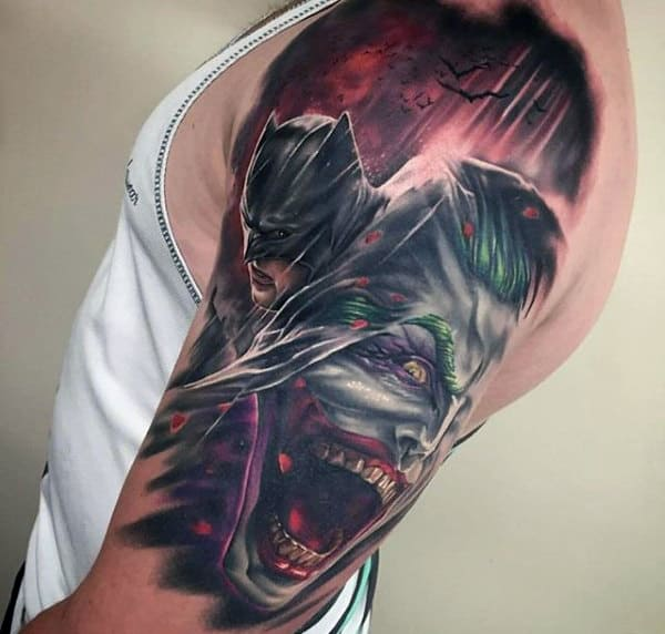 Male With Batman Joker Tattoo On Upper Arm
