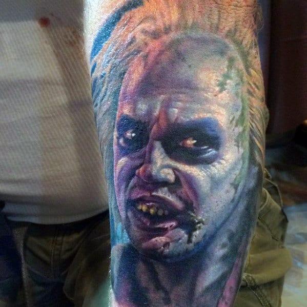 Male With Beetlejuice Portrait Arm Tattoo