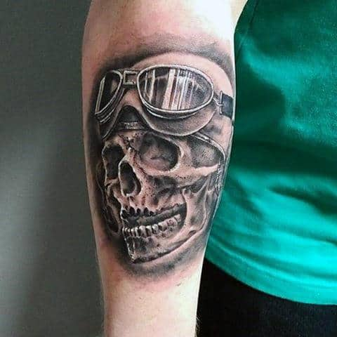 Male With Black And White Skull And Spectacles Tattoo Forearms