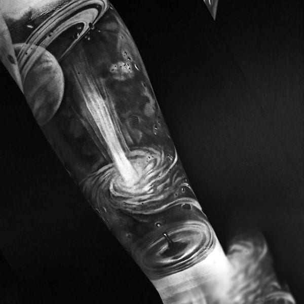 Male With Black And White Universe Tattoo Above Ripples Tattoo On Forarms