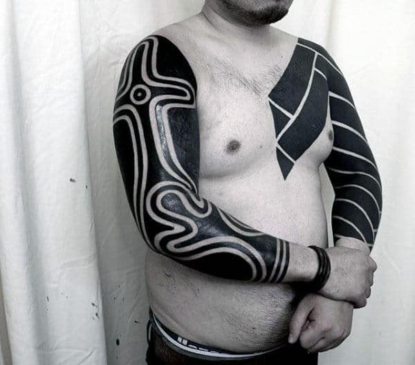 Male With Blackwork Full Arm Tribal Tattoos