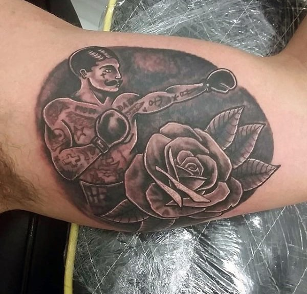 Male With Boxer And Rose Tattoo Inner Biceps
