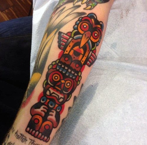 Male With Brightly Colored Neo Traditional Totem Pole Forearm Tattoo