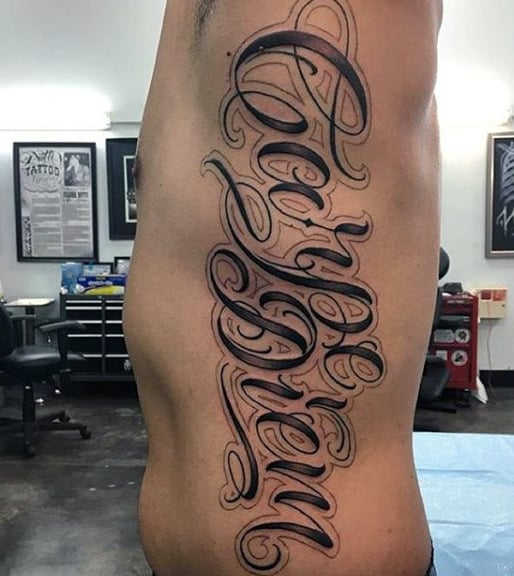 Male With Carpe Diem Rib Tattoo