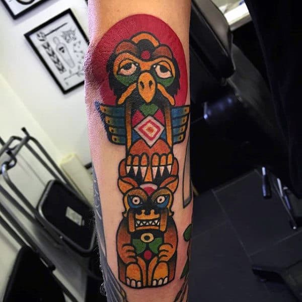 Male With Cartoon Modern Totem Pole Forearm Tattoo