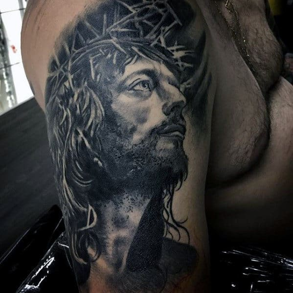 Male With Catholic Jesus Arm Tattoo