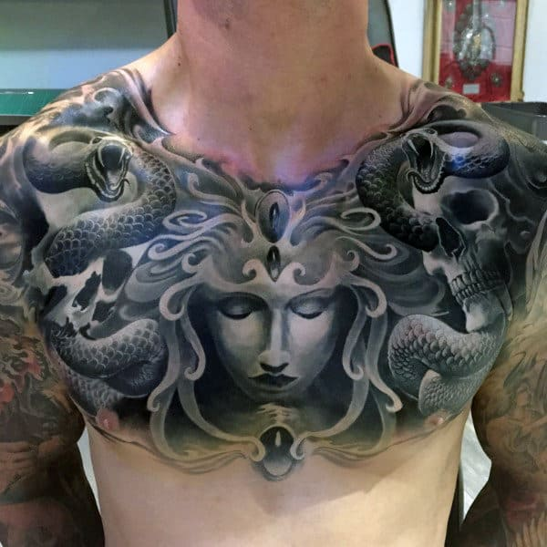 Male With Chest Snake And Female Portrait Tattoo