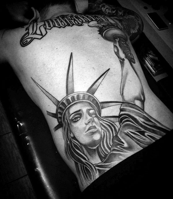 Male With Chicano Statue Of Liberty Back Tattoo