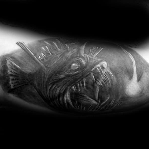 Male With Cool Angler Fish Tattoo Design Black And Grey Ink