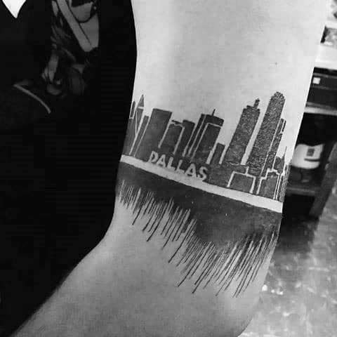 Male With Cool Arm Band Dallas Skyline Tattoo Design