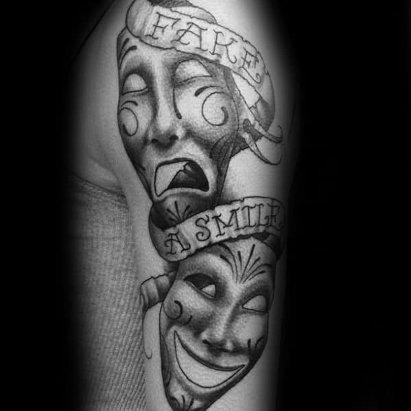 Male With Cool Drama Mask Tattoo Design Fake A Smilie On Arm