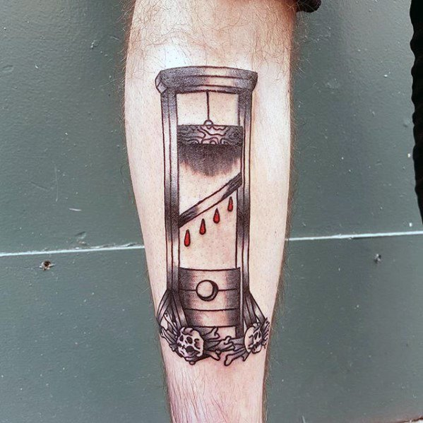 Male With Cool Guillotine Tattoo Design
