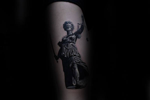 Male With Cool Lady Justice Tattoo Design On Outer Forearm