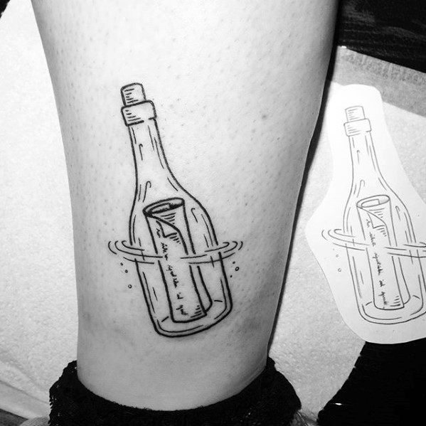 Male With Cool Message In A Bottle Tattoo Design On Lower Leg