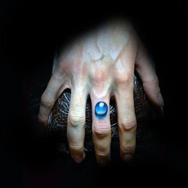 Male With Cool Water Drop Tattoo Design On Finger