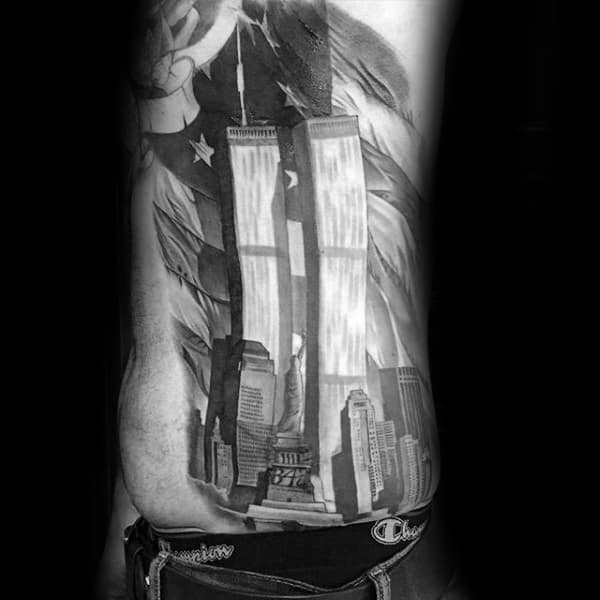 Male With Crazy New York Twin Towers American Flag Rib Cage Side Tattoo Design