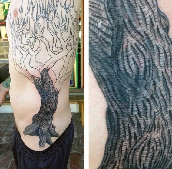 Male With Dark Trunk Oak Tree Tattoo On Side Ribs