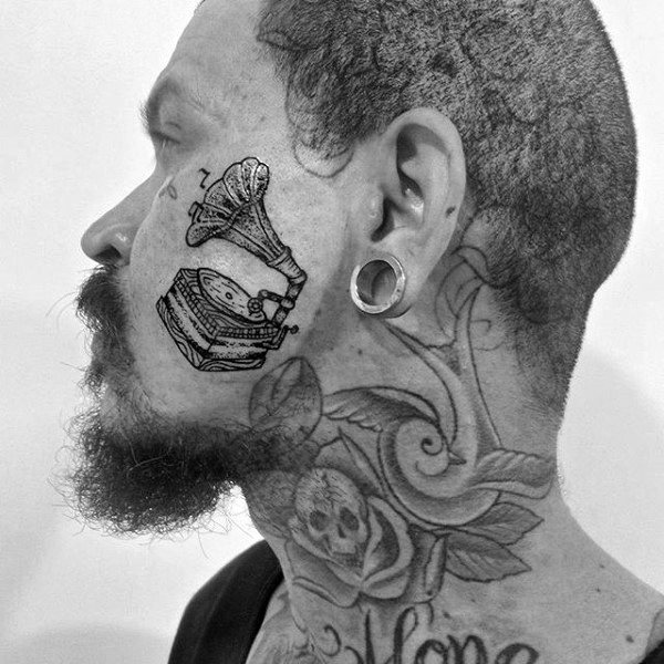 Male With Face Tattoo Of Gramophone
