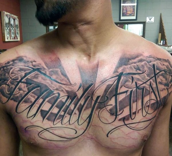 Male With Family First Wordings Tattoo On Chest