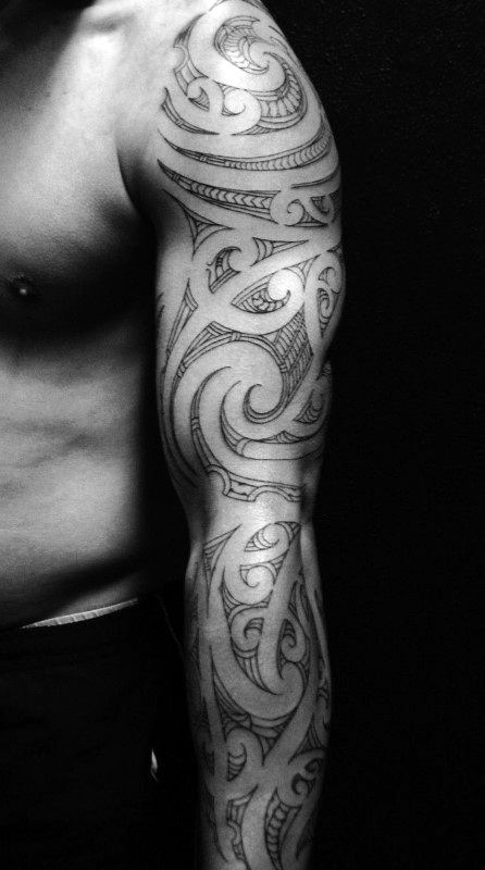 Male With Full Arm Tribal Sleeve Tattoo Design